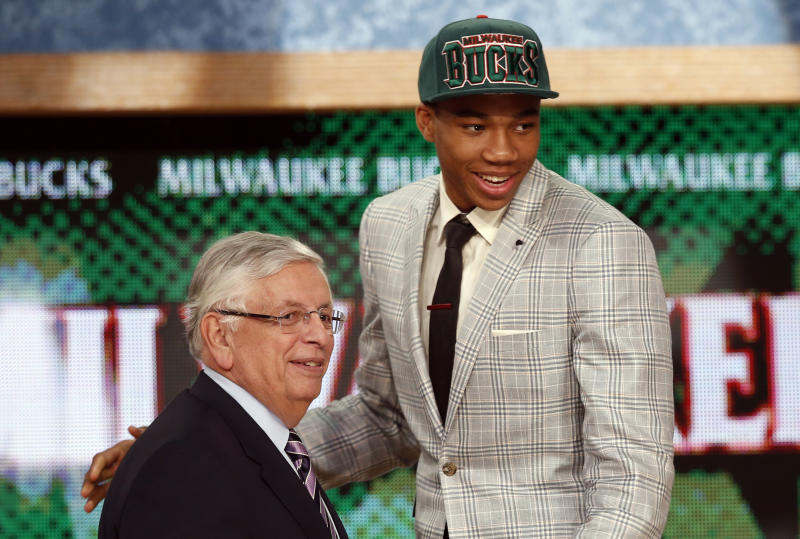 Giannis Antetokounmpo (R) from Greece stands with NBA commissioner David Stern after being selected by the Milwaukee Bucks as the 15th overall pick in the 2013 NBA draft. (Reuters)