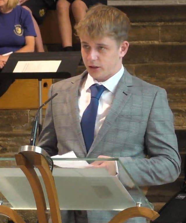 Ms James's son Patrick Davis pays tribute to his mother during the service