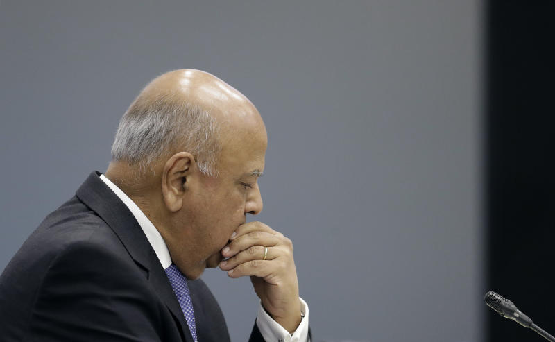 Public Enterprises Minister Pravin Gordhan appears at the judicial commission of inquiry into state capture in Johannesburg, South Africa, Monday, Nov. 19, 2018. Gordhan is expected to reveal details surrounding former president Jacob Zuma's trillion-rand nuclear procurement campaign as well as other corruption practices. (AP Photo/Themba Hadebe)