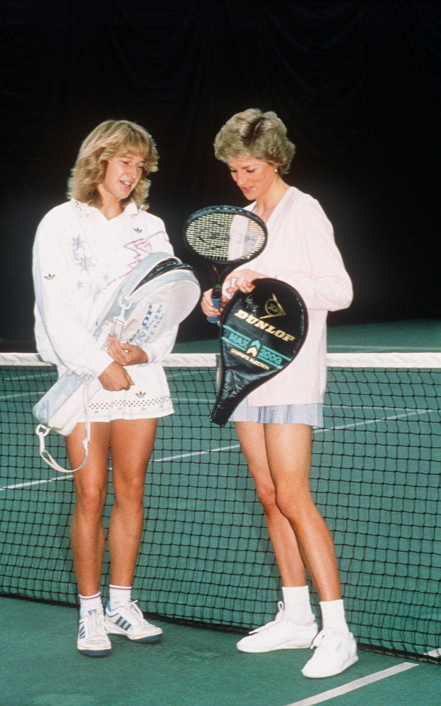<p>Princess Diana and American tennis champion, Steffi Graf, both rocked tennis wear on the court prior to playing a doubles match in 1988. </p>