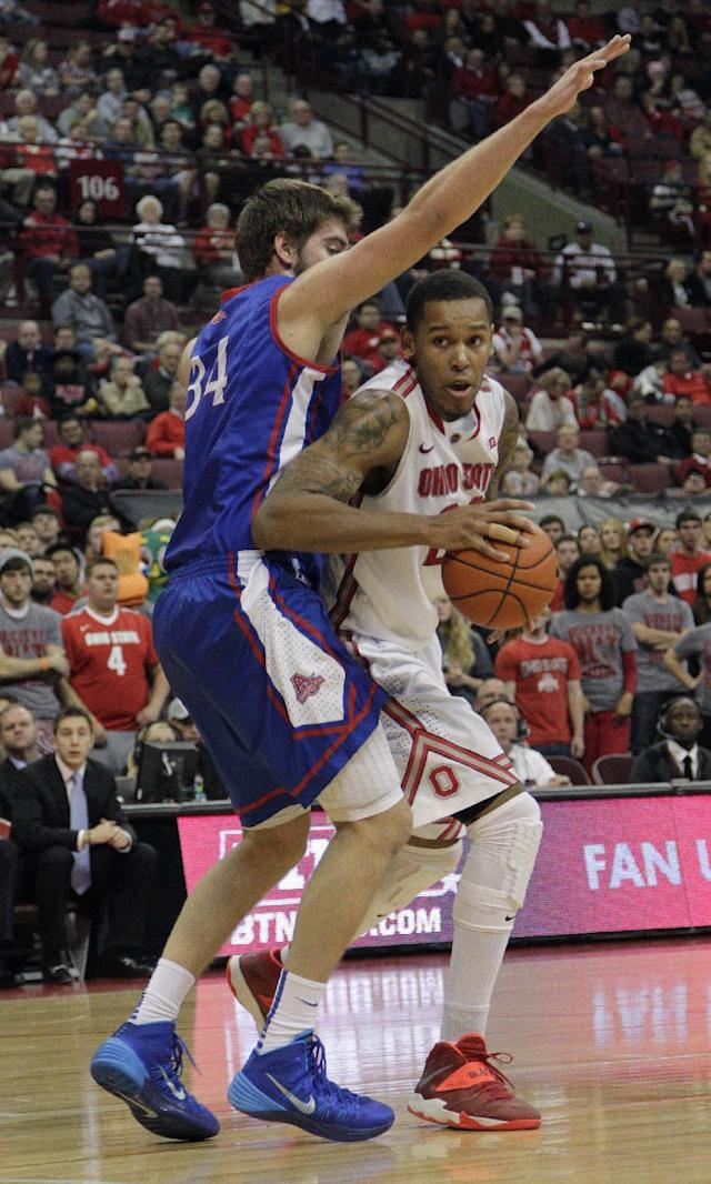 Ohio State's Amir Williams, right, tries to dribble past American's Tony Wroblicky during the second half of an NCAA college basketball game on Wednesday, Nov. 20, 2013, in Columbus, Ohio. (AP Photo/Jay LaPrete)