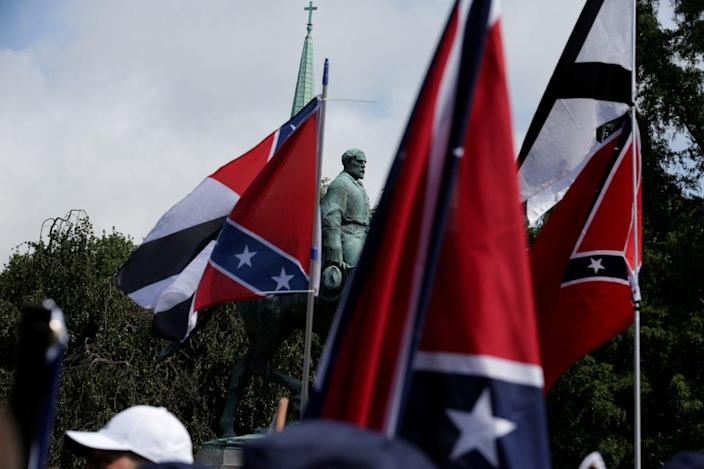 Members of white nationalists rally around a statue of Robert E. Lee