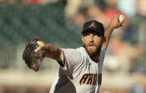 Arizona Diamondbacks pitcher Madison Bumgarner works against the Atlanta Braves in the seventh inning of the second baseball game of a doubleheader, Sunday, April 25, 2021, in Atlanta. (AP Photo/Ben Margot)