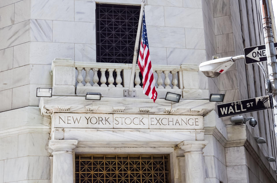 New York, United States - June 18, 2016: New York Stock Exchange with American flags and Wall street sign