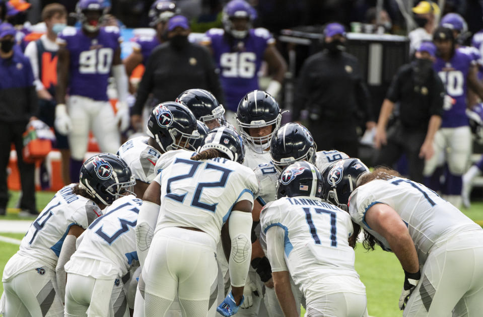 MINNEAPOLIS, MN - SEPTEMBER 27: Tennessee Titans players huddle in the second quarter of the game against the Minnesota Vikings at U.S. Bank Stadium on September 27, 2020 in Minneapolis, Minnesota. (Photo by Stephen Maturen/Getty Images)