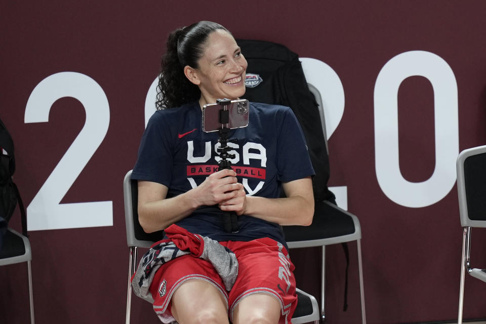 United States' Sue Bird uses her phone to take video of teammates during a women's basketball practice at the 2020 Summer Olympics, Saturday, July 24, 2021, in Saitama, Japan. (AP Photo/Eric Gay)