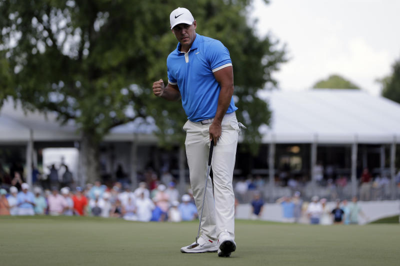 Brooks Koepka celebrates a birdie putt on the 17th green during the final round of the World Golf Championships-FedEx St. Jude Invitational, Sunday, July 28, 2019, in Memphis, Tenn. Koepka won the match. (AP Photo/Mark Humphrey)