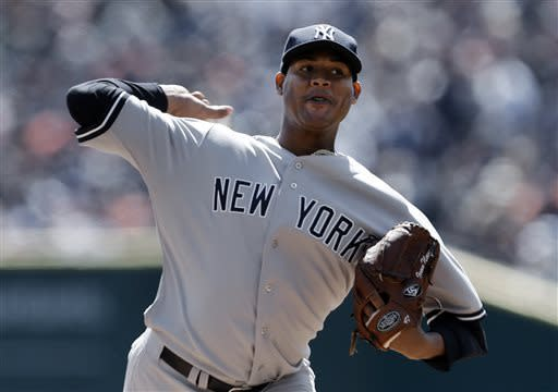New York Yankees pitcher Ivan Nova throws against the Detroit Tigers during the first inning of a baseball game in Detroit, Friday April 5, 2013. (AP Photo/Paul Sancya)
