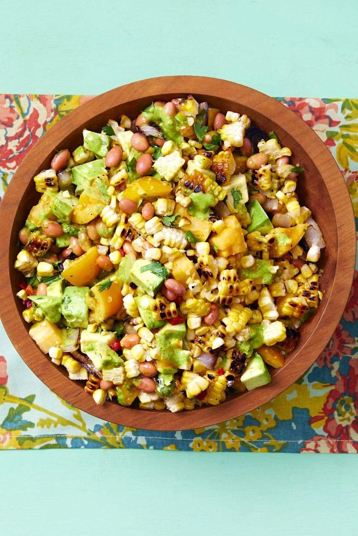 """<p>Looking for a way to serve corn off the cob? Try a grilled corn salad—it's loaded with avocados, beans, tomatoes, and lots of charred corn. </p><p><a href=""""https://www.thepioneerwoman.com/food-cooking/recipes/a32252731/grilled-corn-salad-with-cilantro-vinaigrette/"""" rel=""""nofollow noopener"""" target=""""_blank"""" data-ylk=""""slk:Get Ree's recipe."""" class=""""link rapid-noclick-resp""""><strong>Get Ree's recipe. </strong></a></p><p><a class=""""link rapid-noclick-resp"""" href=""""https://go.redirectingat.com?id=74968X1596630&url=https%3A%2F%2Fwww.walmart.com%2Fsearch%2F%3Fquery%3Dblender&sref=https%3A%2F%2Fwww.thepioneerwoman.com%2Ffood-cooking%2Fmeals-menus%2Fg36353420%2Ffourth-of-july-side-dishes%2F"""" rel=""""nofollow noopener"""" target=""""_blank"""" data-ylk=""""slk:SHOP BLENDERS"""">SHOP BLENDERS</a></p>"""