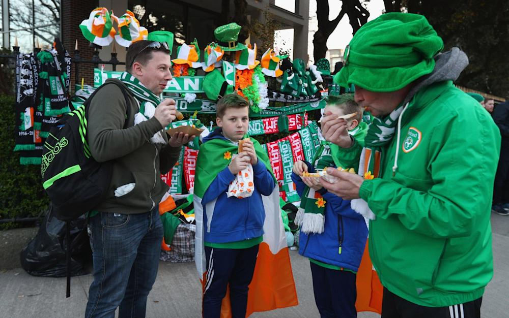 Fans eating chips at the Aviva - Credit: Ian Walton/Getty Images