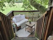 """<p>Offering a whimsical escape surrounded by nature, this idyllic treehouse Airbnb sits in the heart of 30 acres of farmland, in the middle of woodland. It has four levels: the decking under the treehouse with a sofa and gas burner, the ground floor with a teak table and chairs, the first floor with a love seat to enjoy the views and the top floor with a small table and chairs for two. There's no power but portable BBQs are welcome and the bathroom area is outside. This is the place for couples to go completely off grid and get back to nature.</p><p><strong>Sleeps: </strong>Two</p><p><a class=""""link rapid-noclick-resp"""" href=""""https://airbnb.pvxt.net/x9n7O5"""" rel=""""nofollow noopener"""" target=""""_blank"""" data-ylk=""""slk:SEE INSIDE"""">SEE INSIDE</a></p>"""