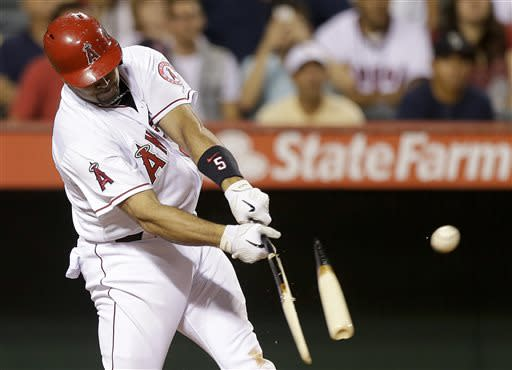 Los Angeles Angels' Albert Pujols hits a RBI-single against the Seattle Mariners during the sixth inning of a baseball game in Anaheim, Calif., Thursday, June 20, 2013. (AP Photo/Chris Carlson)