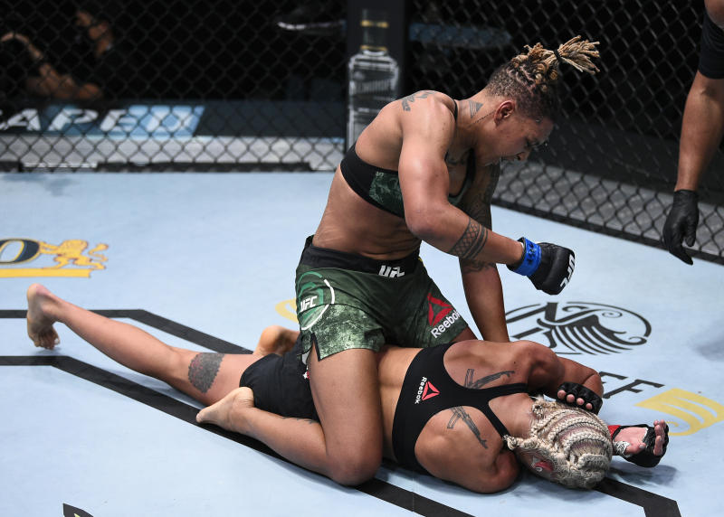 LAS VEGAS, NEVADA - AUGUST 22: In this handout image provided by UFC, Shana Dobson punches Mariya Agapova of Kazakhstan in their flyweight fight during the UFC Fight Night event at UFC APEX on August 22, 2020 in Las Vegas, Nevada. (Photo by Chris Unger/Zuffa LLC via Getty Images)