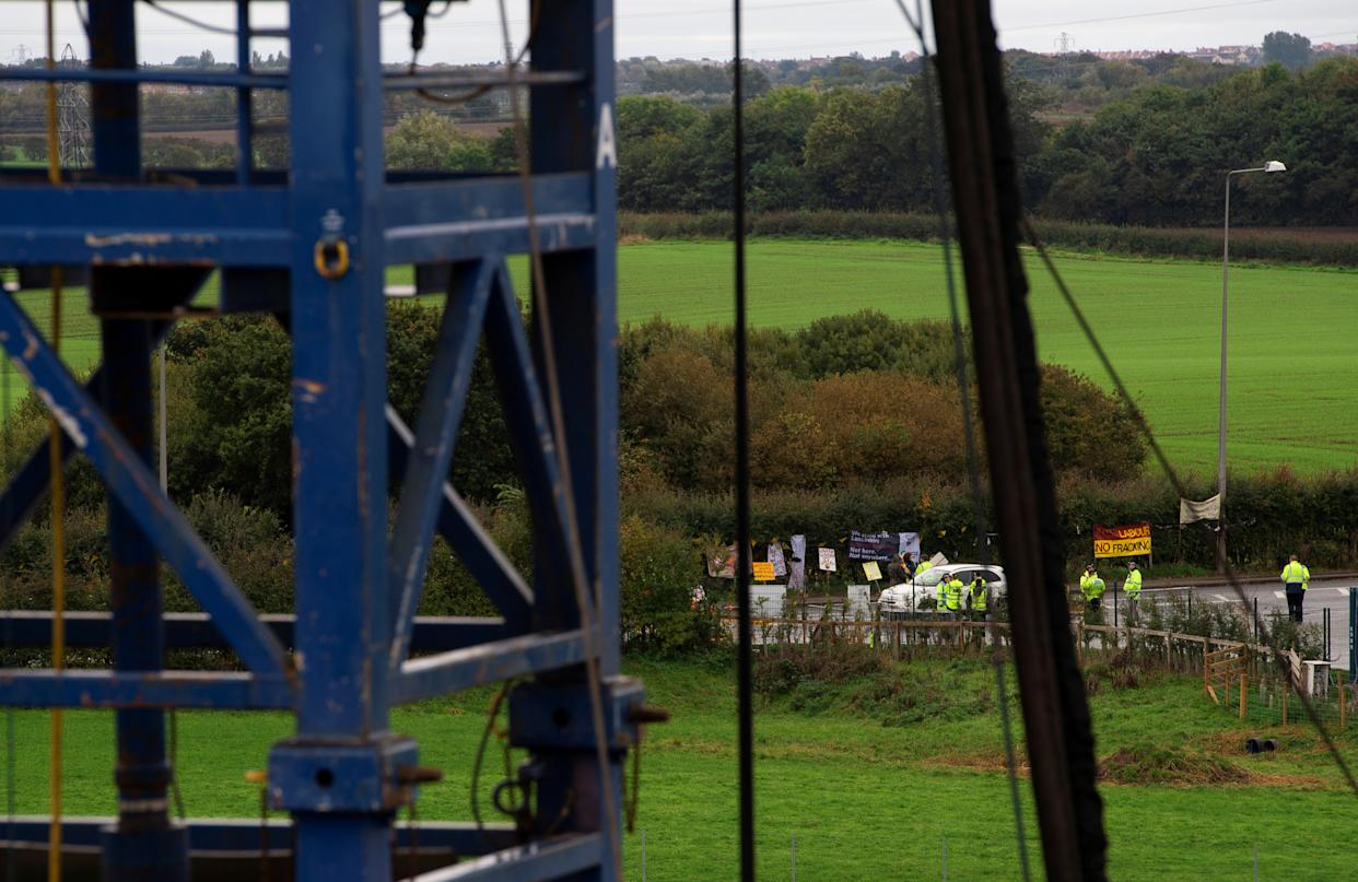 Anti-fracking protesters are seen on the edge of the site where shale gas developer Cuadrilla Resources will start fracking for gas next week at its Preston New Road site near Blackpool, Britain October 5, 2018. REUTERS/Peter Powell