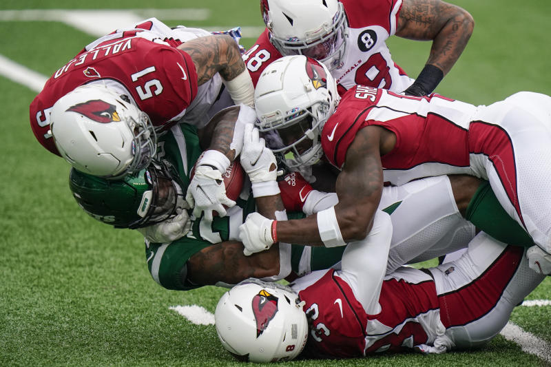 New York Jets running back La'Mical Perine, lower left, is tackled by a group of Arizona Cardinals defenders. (AP Photo/Frank Franklin II)