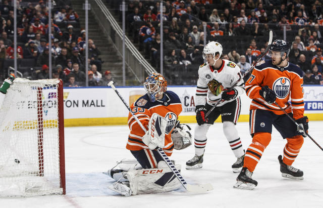 Chicago Blackhawks' Dylan Strome (17) watches the puck go into the net past Edmonton Oilers goalie Cam Talbot (33) as Oscar Klefbom (77) defends during the first period of an NHL hockey game Tuesday, Feb. 5, 2019, in Edmonton, Alberta. (Jason Franson/The Canadian Press via AP)