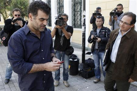 Greek investigative journalist Costas Vaxevanis (L) is seen outside a courthouse in Athens October 8, 2013. REUTERS/John Kolesidis