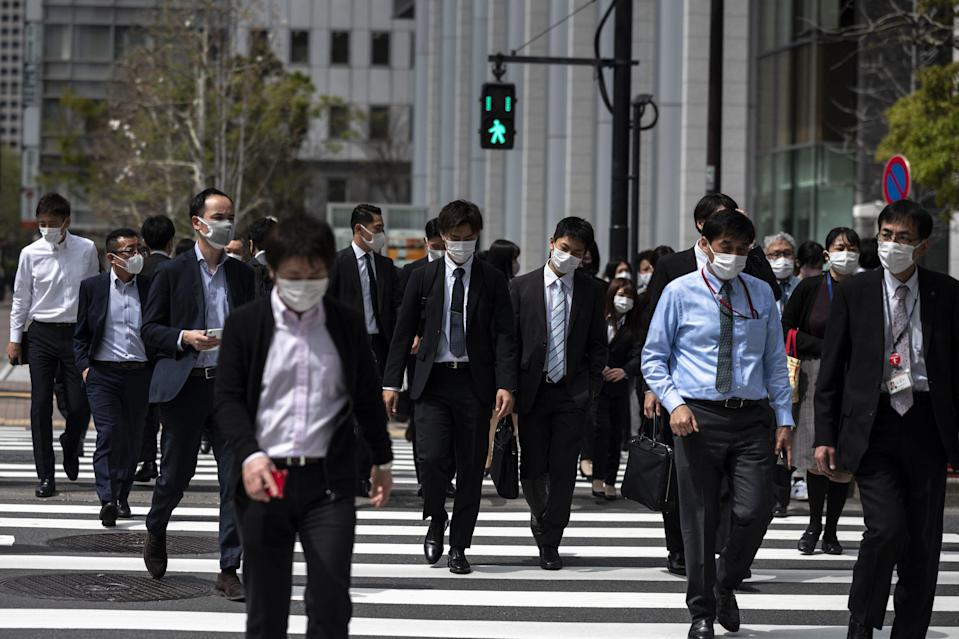 New ways of working have increased productivity for Japanese firms, economists say (AFP via Getty Images)