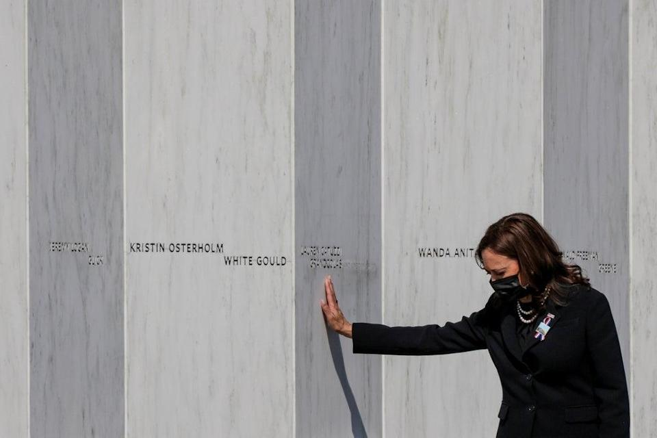 President Kamala Harris touches the Flight 93 National Memorial during an event commemorating the 20th anniversary of the September 11 (REUTERS)