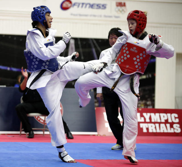 COLORADO SPRINGS, CO - MARCH 10: Diana Lopez (blue) squares off against Danielle Holmquist (red) during the 2012 Taekwondo Olympic Trials at the U.S. Olympic Training Center on March 10, 2012 in Colorado Springs, Colorado. Lopez won the match 3-1. (Photo by Marc Piscotty/Getty Images)