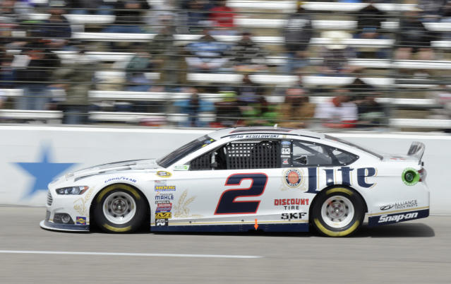 Brad Keselowski (2) takes Turn 4 during the NASCAR Sprint Cup series auto race at Texas Motor Speedway, Monday, April 7, 2014, in Fort Worth, Texas. (AP Photo/Larry Papke)