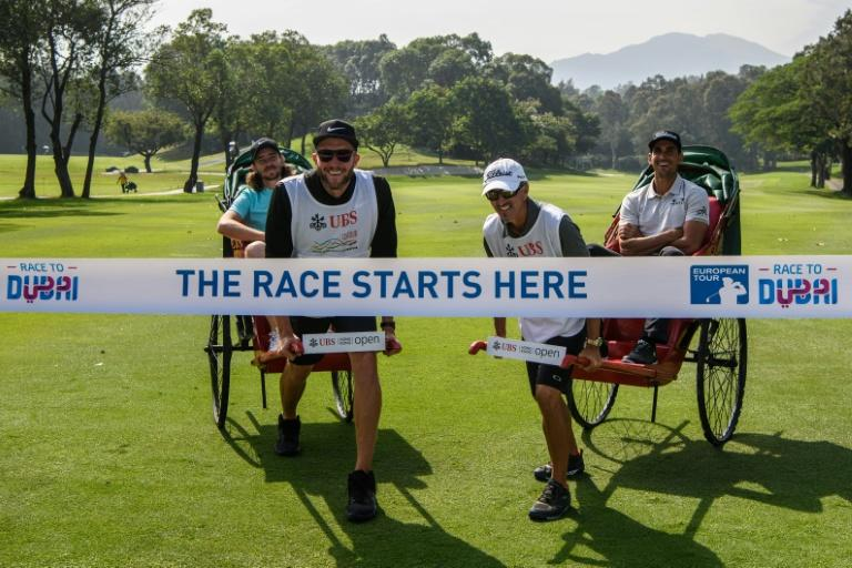 Tommy Fleetwood of England (back L) and Rafa Cabrera Bello of Spain (back R) take part in a photo call during the launch of the 'Road to Dubai', ahead of the Hong Kong Open golf tournament, at the Hong Kong Golf Club, on November 22, 2017