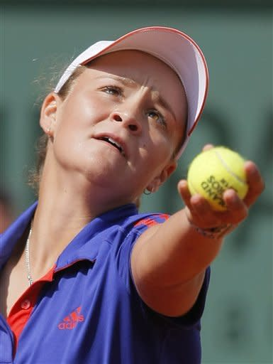 Australia's Ashleigh Barty serves the ball to Czech Republic's Petra Kvitova during their first round match in the French Open tennis tournament at the Roland Garros stadium in Paris, Tuesday, May 29, 2012. (AP Photo/Michel Spingler)