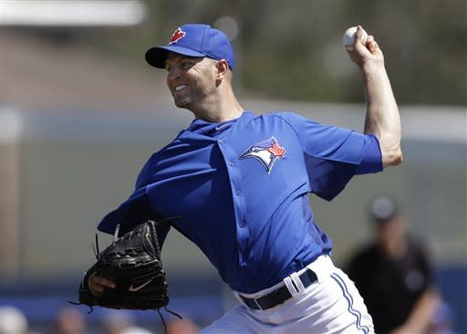 Toronto Blue Jays starting pitcher J.A. Happ delivers in the second inning of a 3-0 loss to the New York Yankees in a spring training baseball game at Steinbrenner Field in Dunedin, Fla., Sunday, March 10, 2013. (AP Photo/Kathy Willens)