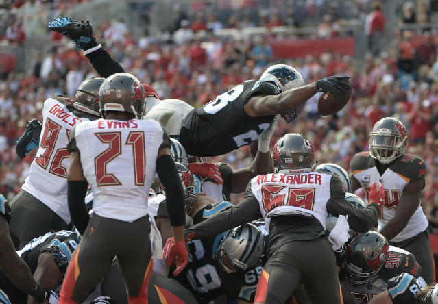 <p>Carolina Panthers running back Jonathan Stewart (28) dives over for a 1-yard touchdown against the Tampa Bay Buccaneers during the first quarter of an NFL football game Sunday, Oct. 29, 2017, in Tampa, Fla. (AP Photo/Phelan Ebenhack) </p>