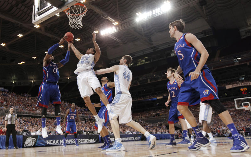 Kansas forward Thomas Robinson (0) and North Carolina forward James Michael McAdoo (43) vie for a rebound during the first half of the NCAA men's college basketball tournament Midwest Regional final Sunday, March 25, 2012, in St. Louis. Kansas won 80-67. (AP Photo/Charlie Riedel)