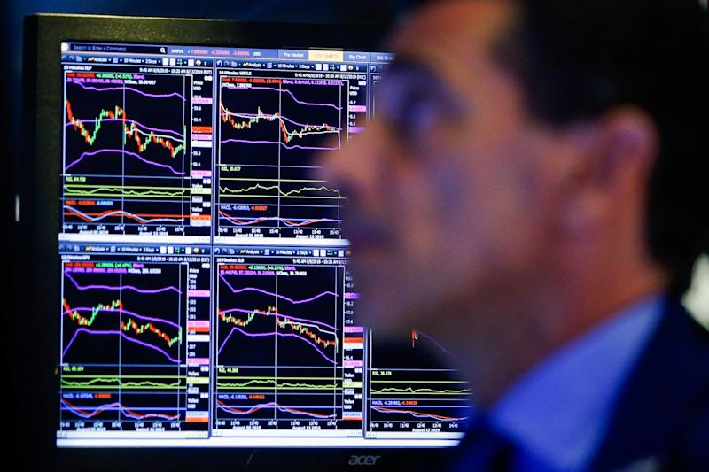 A trader looks at screens as he works on the floor at the New York Stock Exchange (NYSE) in New York, U.S., August 13, 2019. REUTERS/Eduardo Munoz - RC1C0EF05090