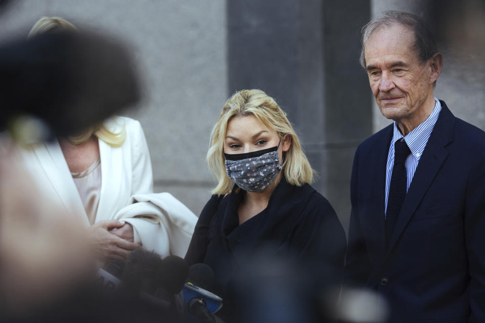 Accuser Danielle Bensky, center, with attorney David Boies, speaks following Ghislaine Maxwell's appearance in Federal Court on Friday, April 23, 2021, in New York. Ghislaine Maxwell, a British socialite and one-time girlfriend of Epstein, pleaded not guilty to sex trafficking conspiracy and an additional sex trafficking charge that were added in a rewritten indictment released last month by a Manhattan federal court grand jury. (AP Photo/Kevin Hagen)