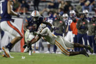 Auburn running back Shaun Shivers (8) tries to get past Tennessee linebacker Quavaris Crouch (27) during the second half of an NCAA college football game Saturday, Nov. 21, 2020, in Auburn, Ala. (AP Photo/Butch Dill)