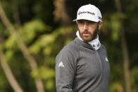 Dustin Johnson walks the 12th fairway during practice before the U.S. Open Championship golf tournament at Winged Foot Golf Club, Tuesday, Sept. 15, 2020, in Mamaroneck, N.Y. (AP Photo/John Minchillo)