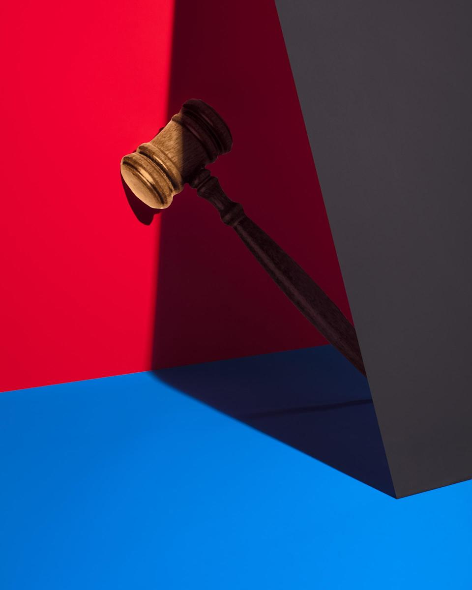 Gavel against red and blue color blocks.