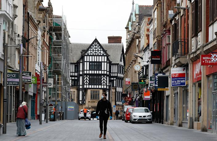 A man walks down a near empty shopping street in Leicester, England, on July 1, 2020. Leicester became the first British city to be put into regional lockdown at the end of June. (Photo: Darren Staples via Getty Images)