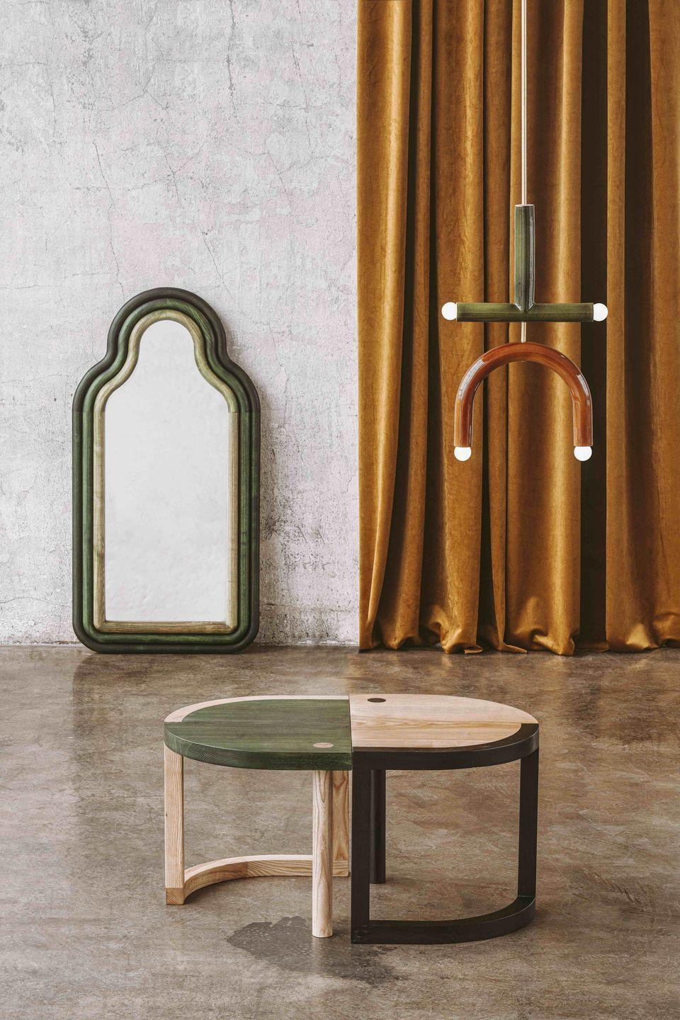 """<p>Pani Jurek's 'TRN' collection was inspired by 20th-century painter Jan Tarasin's colourful, symbol-filled canvases. The series of sustainably made furniture and lighting is intended to be used together to build up abstract compositions (the tables can be placed together to create a larger one, as pictured), and no two pieces are exactly alike. £1,179, <a href=""""https://www.adorno.design"""" rel=""""nofollow noopener"""" target=""""_blank"""" data-ylk=""""slk:adorno.design"""" class=""""link rapid-noclick-resp"""">adorno.design</a></p>"""