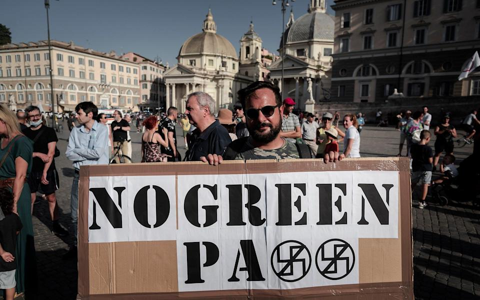 """Demonstrators in Italy take part in a demonstration, organized by the No Vax and far-right movements against the """"Green Pass"""", - Corbis/Corbis"""
