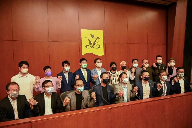 Pro-democracy lawmakers attend a press conference at the government headquarters in Hong Kong on November 9, 2020