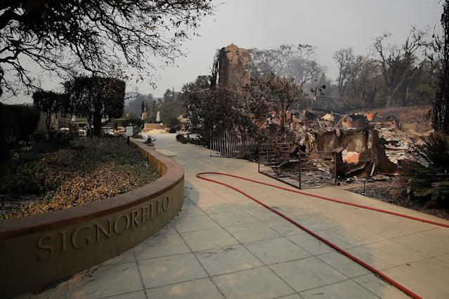<p>The remains of the fire damaged Signarello Estate Winery after an out of control wildfire moved through the area on Oct. 9, 2017 in Napa, Calif.(Photo: Justin Sullivan/Getty Images) </p>