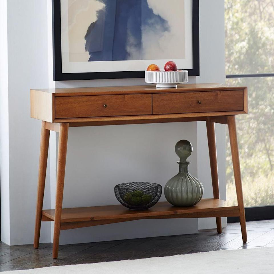 <p>This <span>West Elm Mid-Century Console</span> ($509) is great for someone who loves midcentury-modern designs.</p>