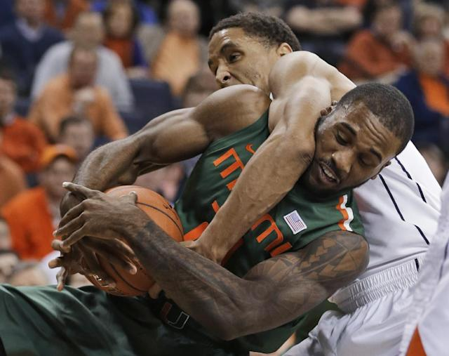 Miami forward Erik Swoope, front, struggles for a rebound with Virginia guard Malcolm Brogdon during the first half of an NCAA college basketball game in Charlottesville, Va., Wednesday, Feb. 26, 2014. (AP Photo/Steve Helber)