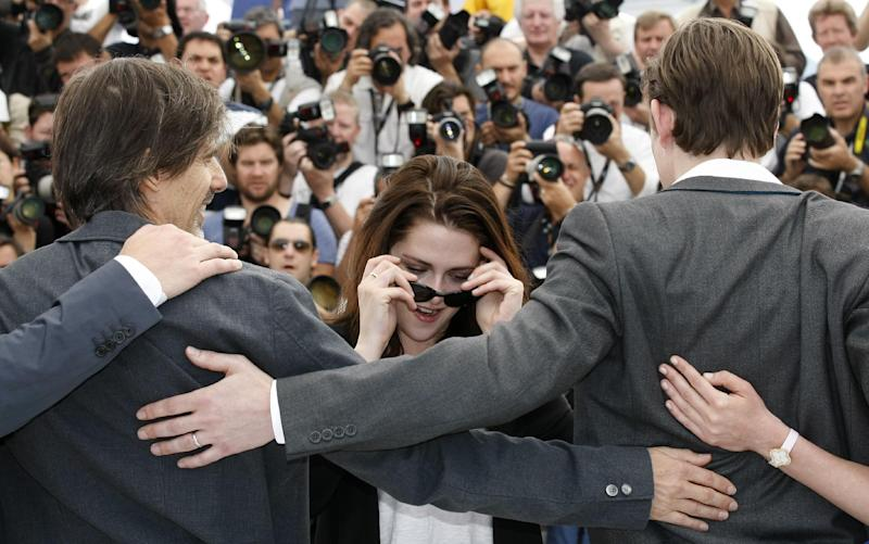 Director Walter Salles, left, actors Kristen Stewart and Sam Riley pose during a photo call for On the Road at the 65th international film festival, in Cannes, southern France, Wednesday, May 23, 2012. (AP Photo/Lionel Cironneau)
