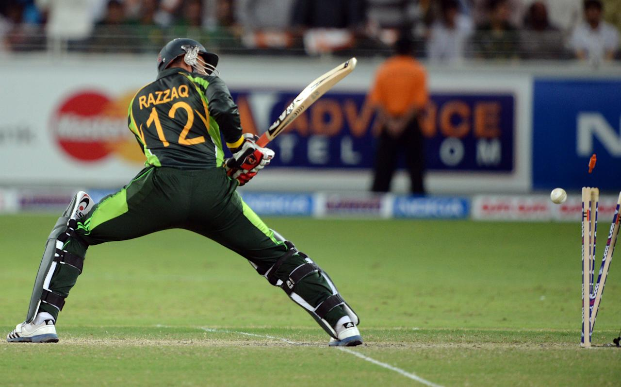 Pakistani batsman Abdul Razzaq is clean bowled by South African bowler Imran Tahir (unseen) during second and last T20 international at Dubai stadium on November 15, 2013. South Africa sparked another Pakistan batting collapse to win the second Twenty20 international by six runs, taking the two-match series 2-0. AFP PHOTO/ Asif HASSAN        (Photo credit should read ASIF HASSAN/AFP/Getty Images)