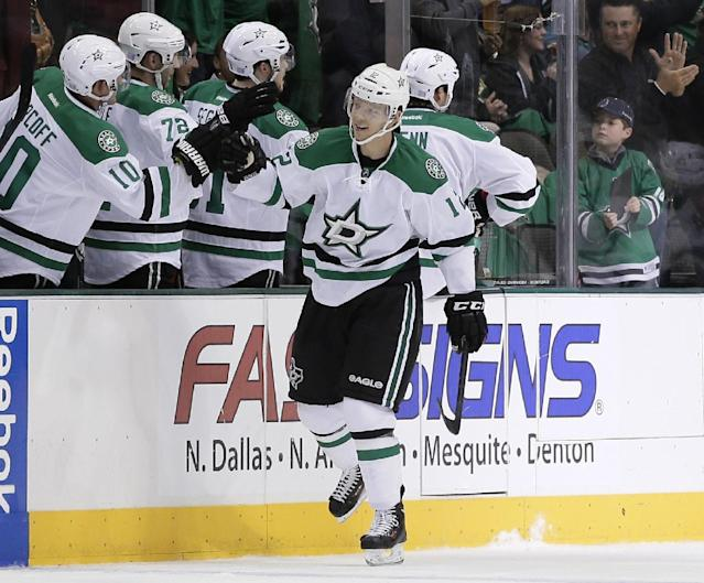 Dallas Stars' Alex Chiasson (12) is congratulated by Shawn Horcoff (10) and the rest of the bench following his goal against the Washington Capitals in the second period of an NHL hockey game on Saturday, Oct. 5, 2013, in Dallas. (AP Photo/Tony Gutierrez)