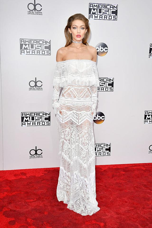 <p>As host of the American Music Awards, Gigi Hadid looked gorgeous in a white gown on the red carpet that was paired with a shiny choker. Her hair was slicked back and she made a statement with a red lip. <em>(Photo: Getty Images)</em> </p>