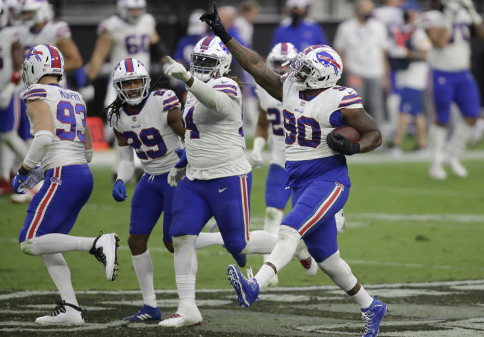 FILE - In this Oct. 4, 2020, file photo, Buffalo Bills defensive tackle Quinton Jefferson (90) celebrates after recovering a fumble by the Las Vegas Raiders during the second half of an NFL football game in Las Vegas. (AP Photo/Isaac Brekken, File)