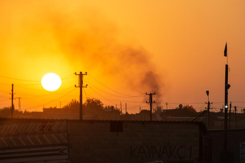 Smoke billows from a village on the Syrian side of the border on Oct. 9, 2019 in Akcakale, Turkey. (Photo: Burak Kara/Getty Images)