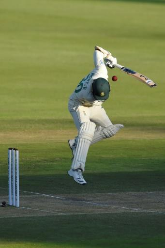 Anrich Nortje reacts after being hit by a ball delivered by Ben Stokes