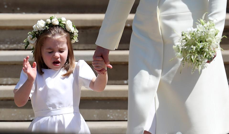 WINDSOR, UNITED KINGDOM - MAY 19:  Princess Charlotte of Cambridge stands on the steps with her mother Catherine, Duchess of Cambridge after the wedding of Prince Harry and Ms. Meghan Markle at St George's Chapel at Windsor Castle on May 19, 2018 in Windsor, England. (Photo by Jane Barlow - WPA Pool/Getty Images)